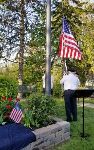 A color guard raises flags at the Veterans' Memorial Park during the May 23 event. Photo by Dianne Hickerson.