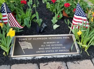 At left, the plaque was unveiled and a wreath placed in front at the May 23 event. Photo by Dianne Hickerson.