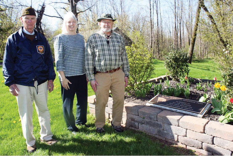 Shown (l-r): Kermit Mercer, Jackie Smith and Bill Fine standing at the Town of Clarkson Veterans Park near the plaque to be dedicated on May 23. Provided photo