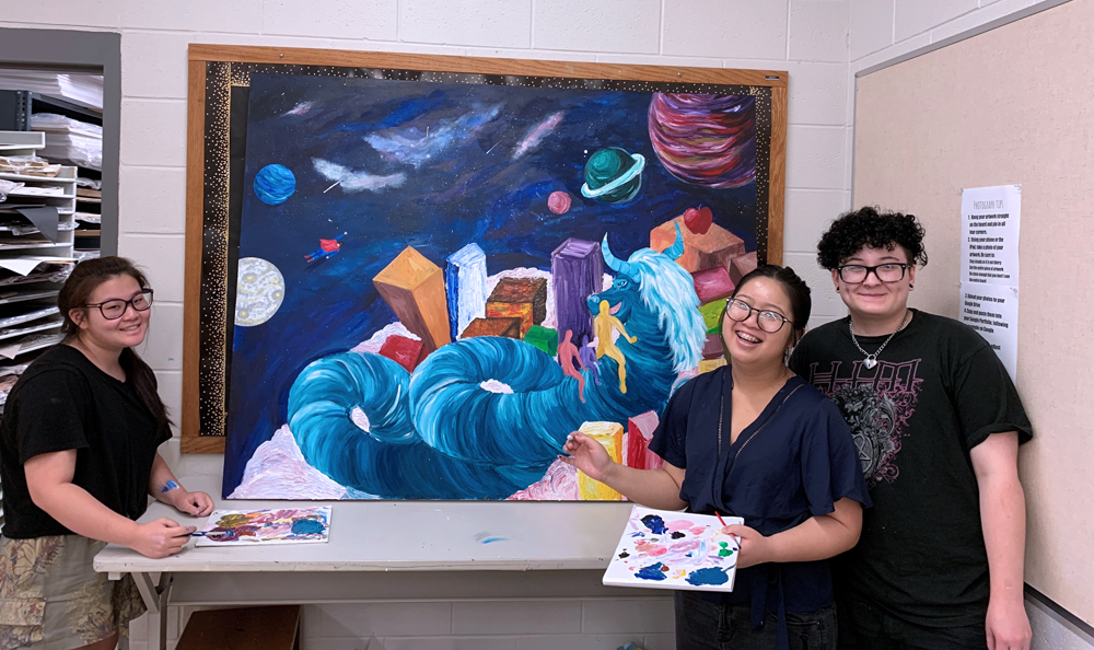 Churchville-Chili High School artists imagined a magical, hopeful world. Shown (l-r) Alexis Chanthachackvong, Renee Guerin and Aubin Ross-Guarino. Not present: Carmelo Ortiz, Rachel Miller and Jason Gibbs.
