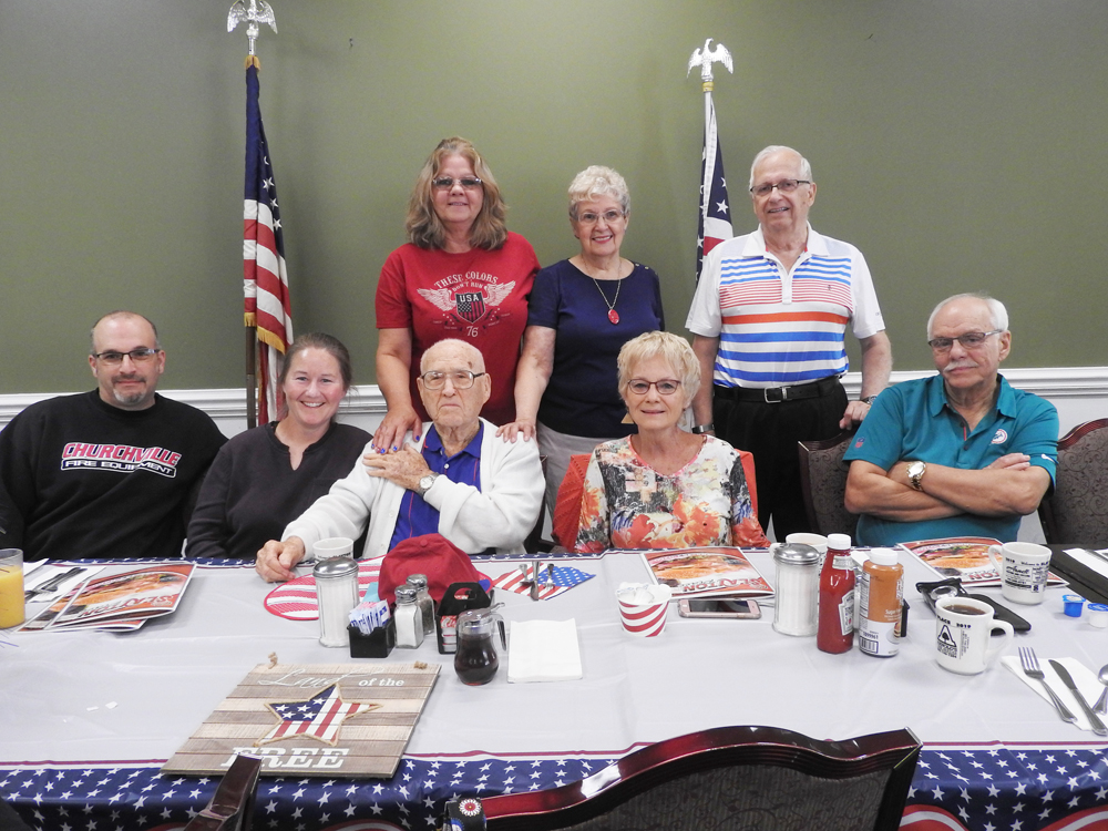 Family, friends and neighbors attended the breakfast event. Seated (l-r) Paul Caton, granddaughter Melinda Walker, Gene Walker, daughter-in-law Shery Walker, friend Ray Czarniak. Standing (l-r) Nancy Stavalone, Sandy Saylor and Lee Arbegast.