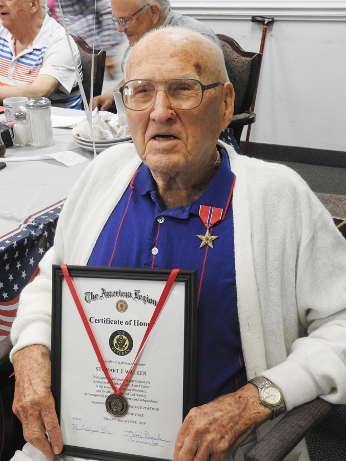 On June 12 Gene Walker received the Bronze Star Medal, Certificate of Honor, Medic Badge and two Silver Stars.