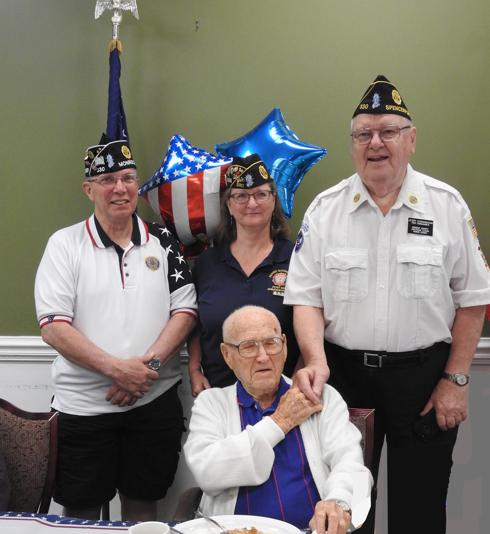 Gene Walker with (l-r) Don Sisson, Vice Commander Monroe County American Legion; Jane Decker, Vice Commander Ferris Goodridge Post 330; and Jerry Cunningham, Monroe County American Legion Honor Guard.