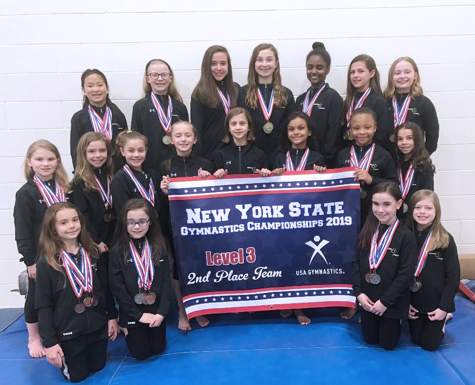 Bright Raven Level 3 Team with State Meet Banner (l-r): front row Calla Crowley (Ogden), Emma Brumbaugh (Chili), Molly McJury (Brockport), Caitlin Nowak (North Chili); middle row Kailee Anstey (Holley), Ashley Magin (Spencerport), Ava Boon (Scottsville), Lauren Coccia (Churchville), Hailey Neumann (Brockport), Rachel Lynck (Chili), Saveyah Nickson (North Chili), Ava Marks (West Henrietta); back row  Sara Bishop (Hilton), Norah DeRosia (North Chili), Chloe Osterling (North Chili), Kelsey Magin (Spencerport), Hlina Alemu (West Henrietta), Bella Forkell (Chili), Avery Overacker (North Chili). Elliana Visca and Maayan Nachshon not in photo