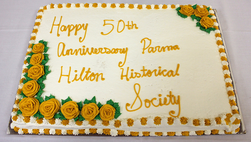 The cake served at the Parma Hilton Historical Society's 50th Anniversary Banquet was adorned with gold colored roses.
