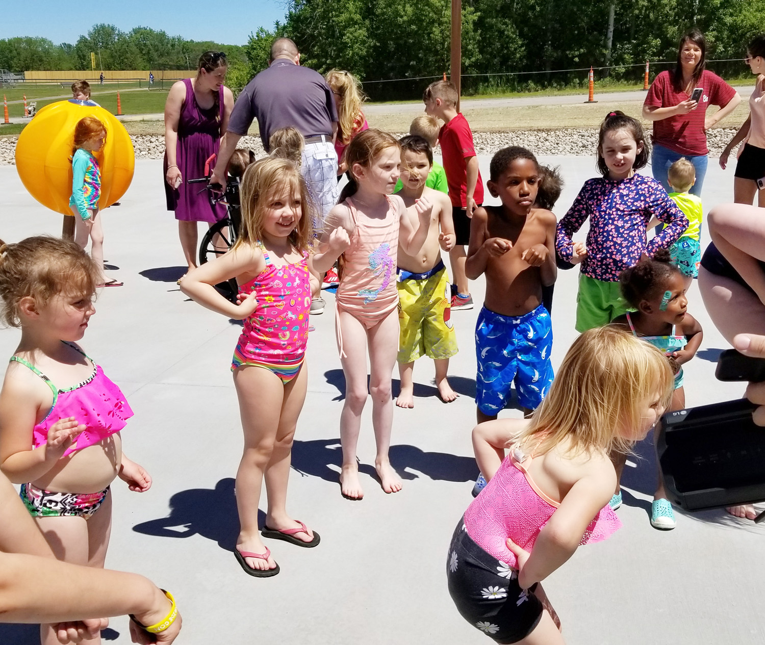 Kids eagerly await the water turning on in the new Splash Pad. Water flowed just after this photo was taken. Photo by Dianne Hickerson
