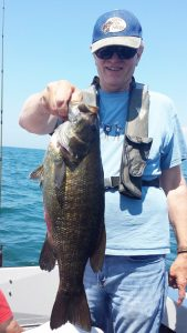 Greg Jones of Victor with a nice Lake Erie smallmouth. Greg is a hardcore bass fisherman who fished over 100 days last year, landing more than 1,000 bass. Provided photo