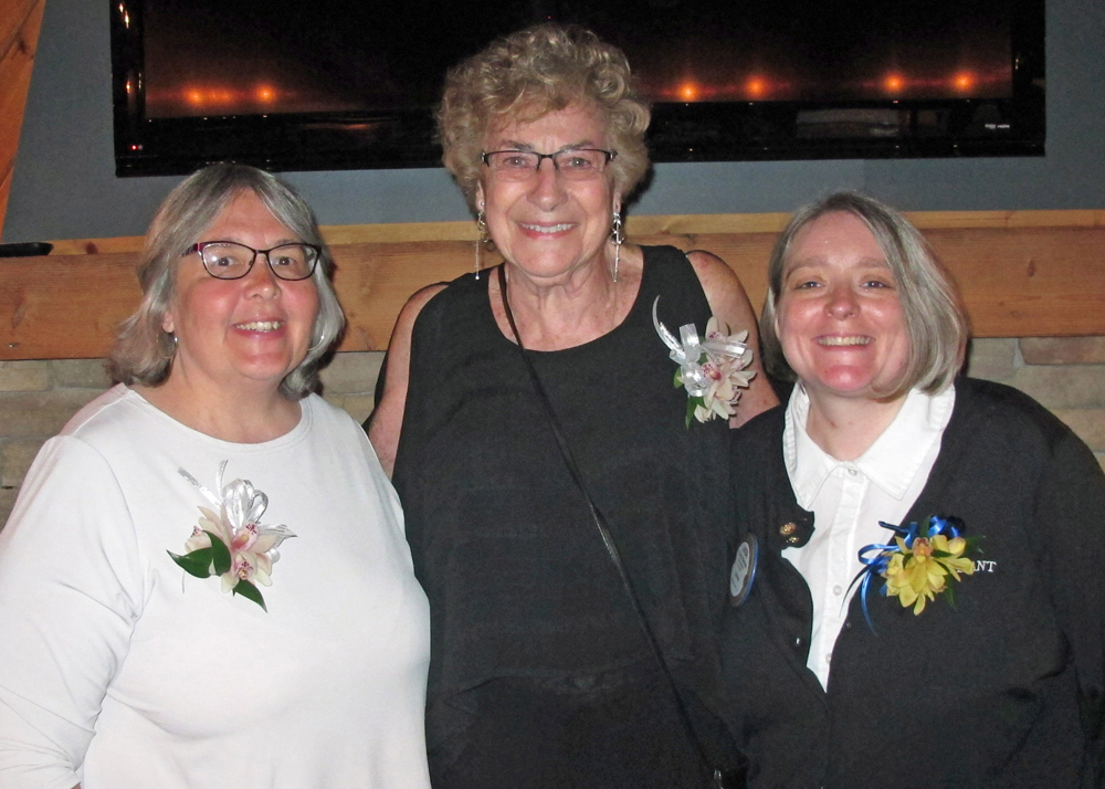 Shown (l-r) are award winners Mary Jo Orzech and Rosie Rich with outgoing president Linda Menear.