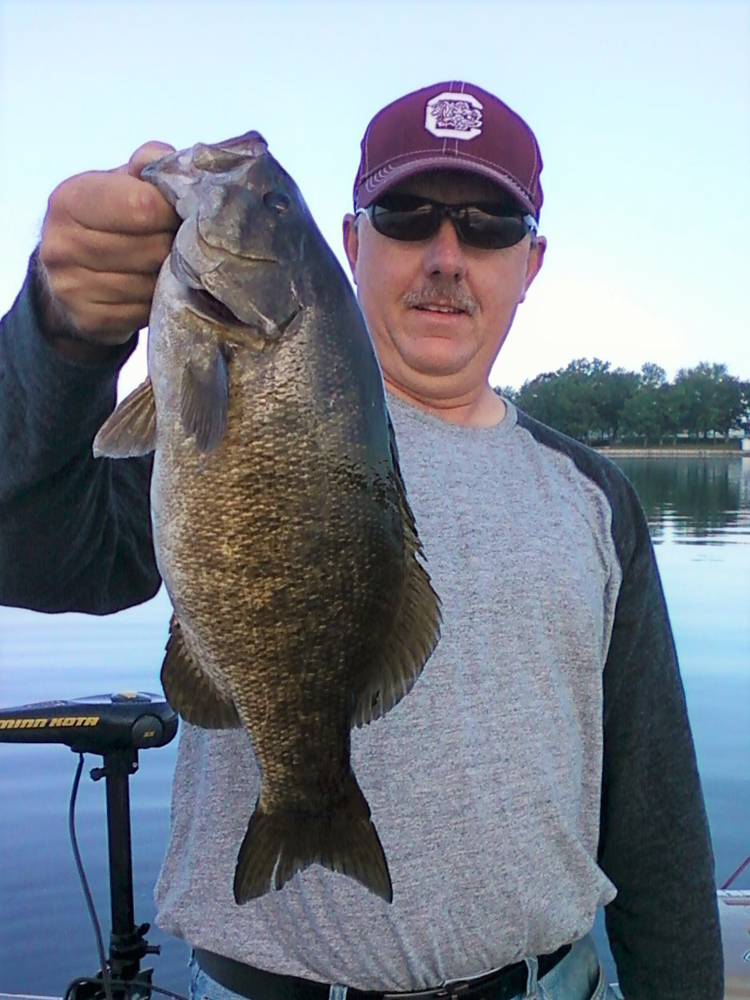 Veteran bass angler Bob Hendrick with a good example of the size these Thousand Island region smallmouth bass are now growing to. Provided photo