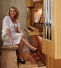 """Brenda Tremblay sits at the console of St. Luke's new pipe organ. The photo shows some of the new pipes and the """"case"""" made of white oak. Photo by Dianne Hickerson"""