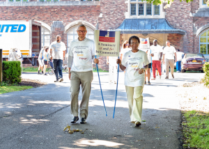 President Angela Sims (right), CRCDS leaders, faculty, staff and students shared a special moment of remembrance at the original campus, and marched down Goodman Street to the new, more centrally located campus.