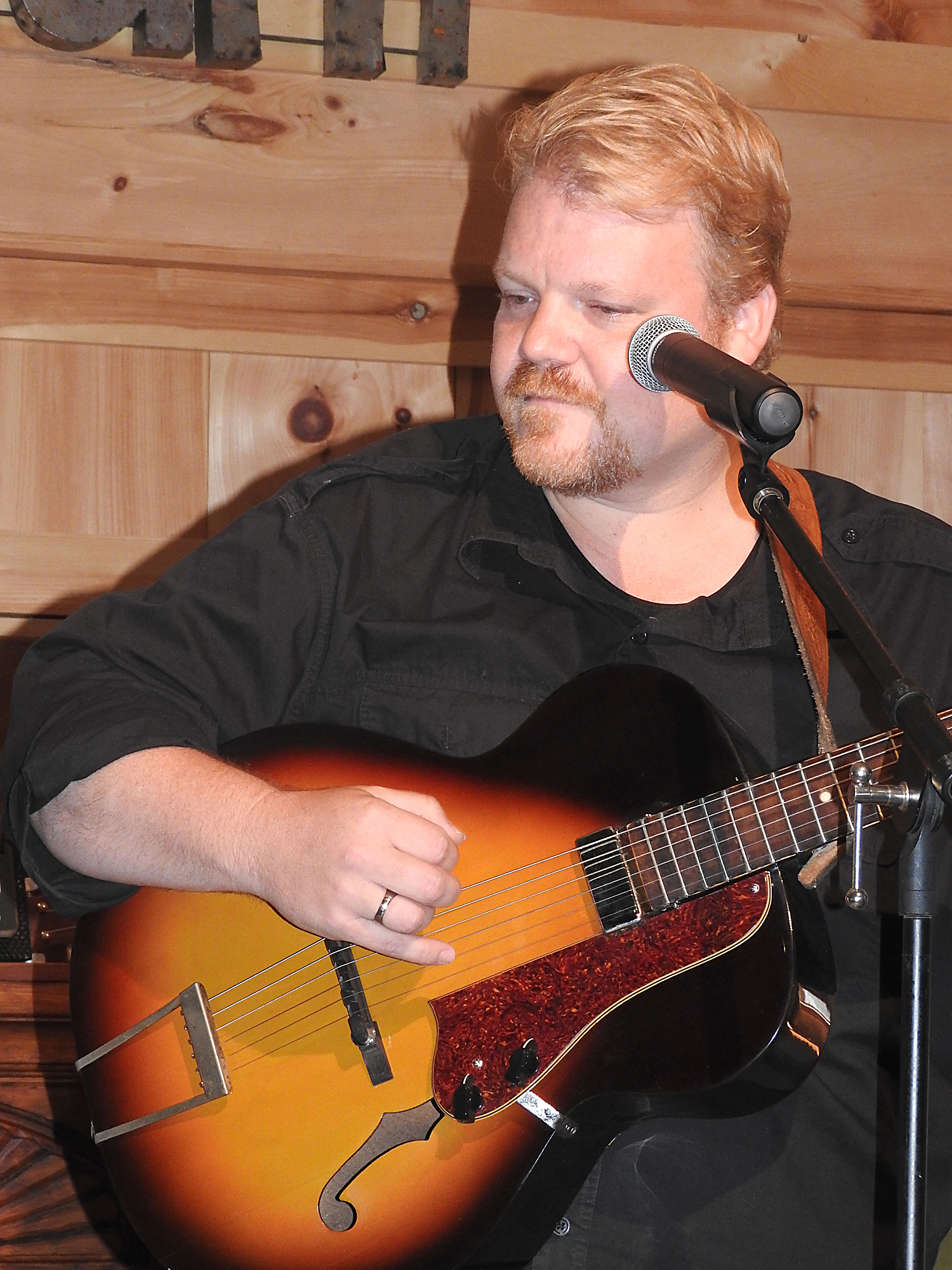 Chris Wilson hosts a house concert at The Barn once a month. Photo by Karen Fien