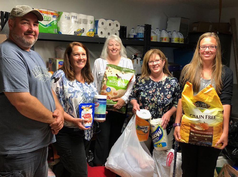 Shown (l-r) are Dave Maynard, Leslie Zink, Jackie Smith, Christa Filipowicz and Keylee Gilfilian with some of the items donated during the drive.