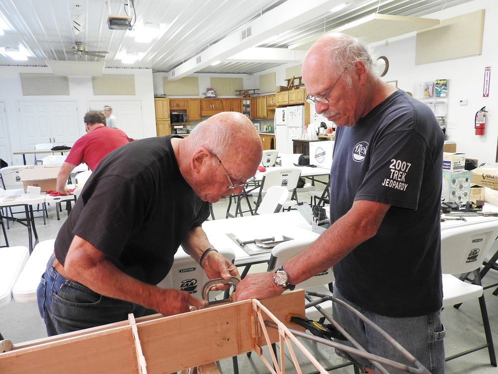 Jim Gooding and Pete Bonneau working on the rib.
