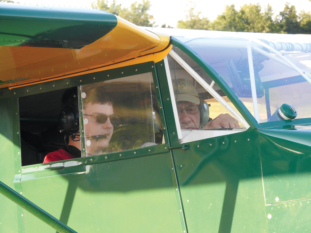 Tyler Mullen and Earl Luce flying Buttercup.