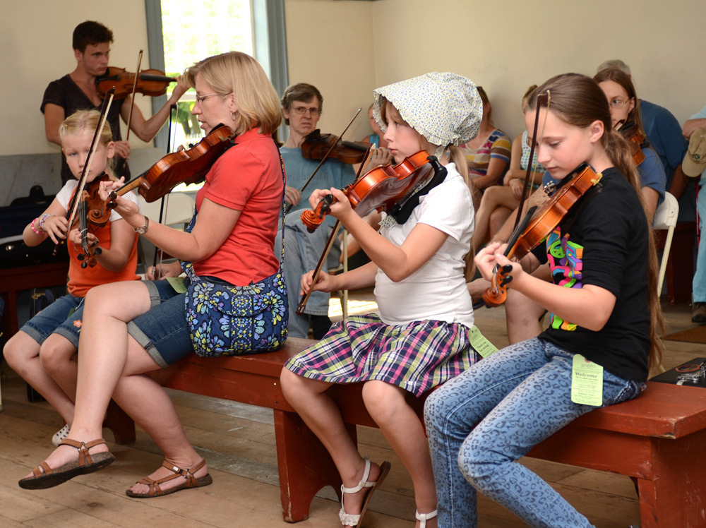 Kids fiddling workshop. Photo by Ruby Foote