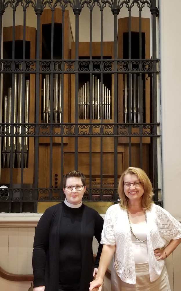 Standing in St. Luke's Episcopal Church in front of the new pipe organ are: (left) The Reverend Elizabeth Harden and Brenda Tremblay, organist and choir director. Photo by Dianne Hickerson