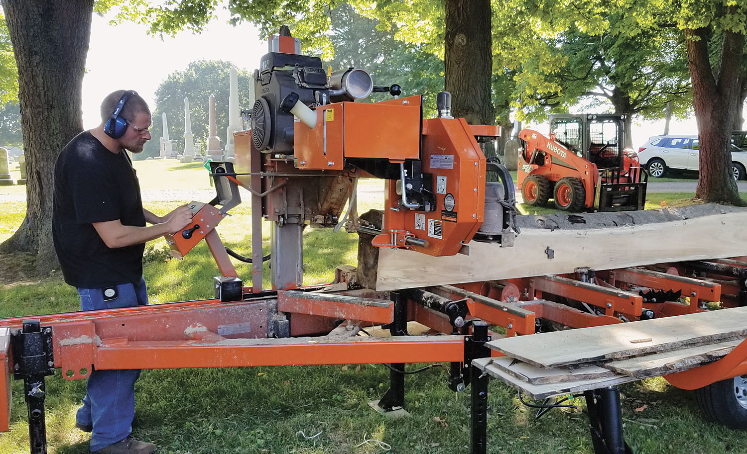 "At the 2018 Harvest Fest, many kinds of machinery were demonstrated. Here, Richard Jurzysta operates the ""Woodmizer LT35"" full hydraulic saw that turns lumber into beams, mantels, and other things. The horizontal band saw moves along a stationary log at a specified thickness. Photo by Dianne Hickerson"