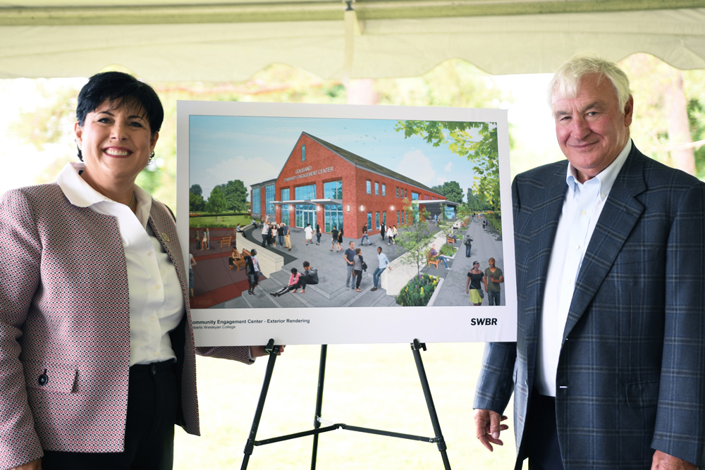 Roberts Wesleyan College President Deana L. Porterfield and Tom Golisano with a rendering of the Golisano Community Engagement Center slated to begin construction in the fall of 2020.