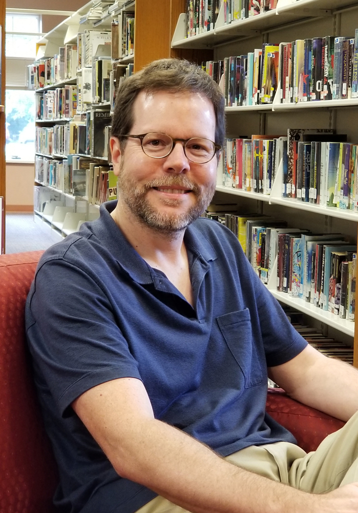Mike Boedicker relaxes in Seymour Library where he is the new Director. Photo by Dianne Hickerson.
