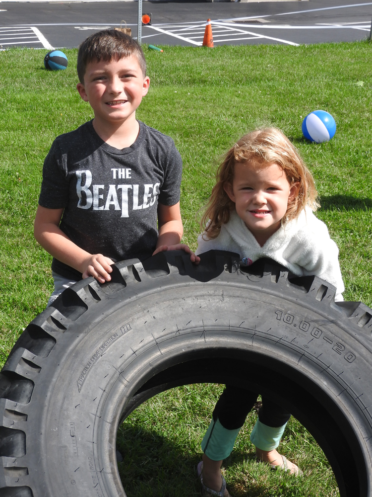Cameron Fien and Chloe Caruso tried out the tire flipping event.