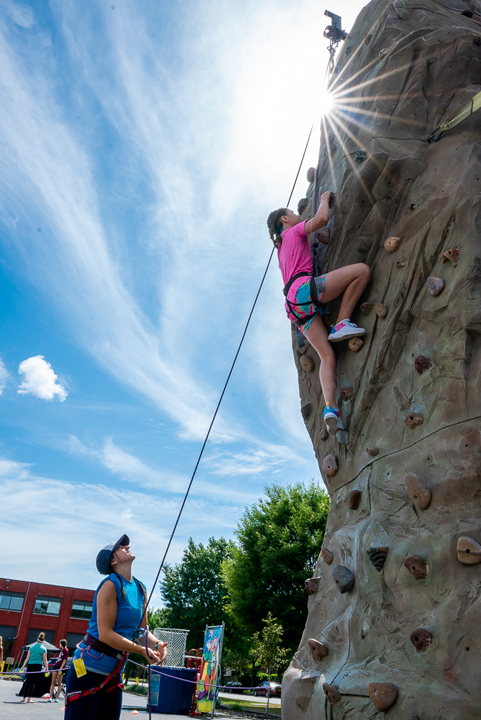 Attendees can scale a climbing wall provided by Roc Ventures.