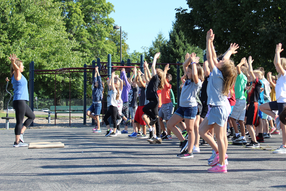 Kathy Netti led students in breathing, yoga, and mindfulness exercises on the playground.