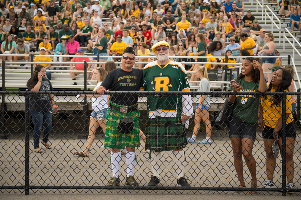 Two men showing their Brockport spirit at the 2018 Homecoming football game.