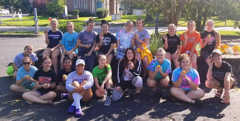 """Byron-Bergen Volleyball players show off the potatoes they cleaned and prepared at the annual """"potato scrub."""""""