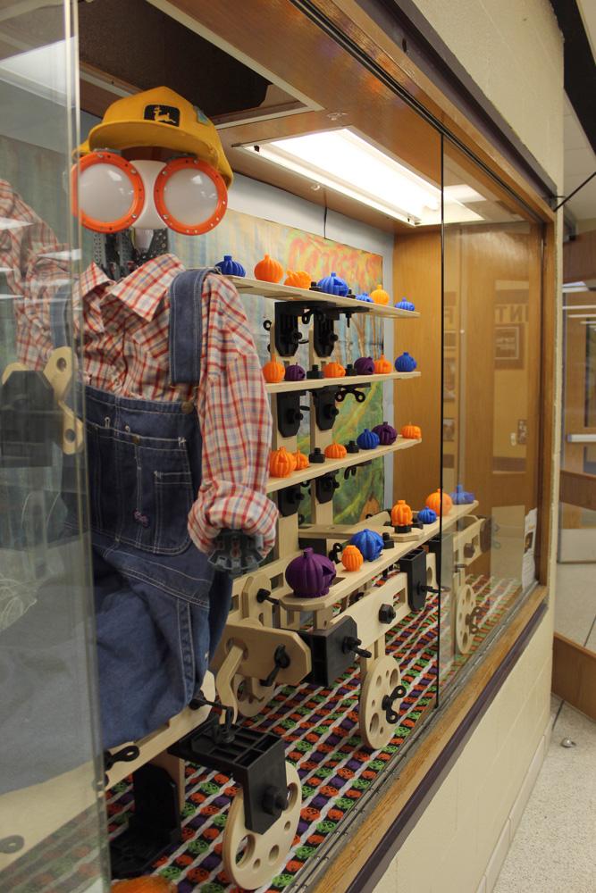 STEAM Lab mascot Byron with 3-D printed pumpkin display.
