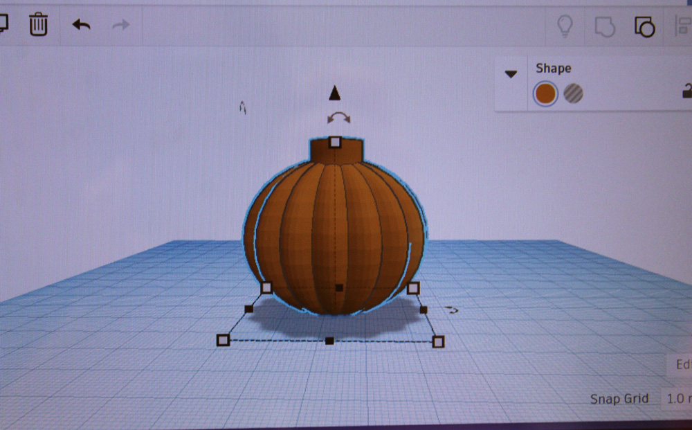 A student project takes on the shape of a pumpkin.