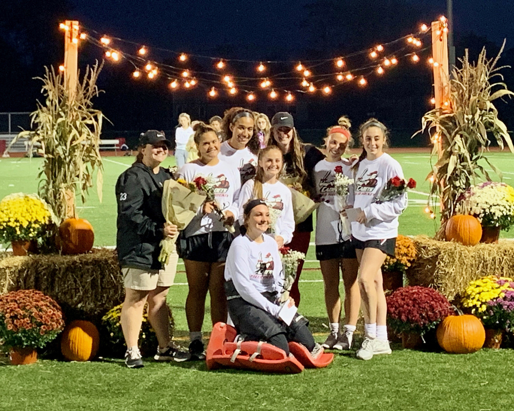 Shown (l-r) assistant coach Morgan Flamholtz, Nora Coon, Paige Favor, Bridget Huber, Maria Palma, Kaia McCue, and (kneeling) Haley Chamberlain. Photo by Warren Kozireski