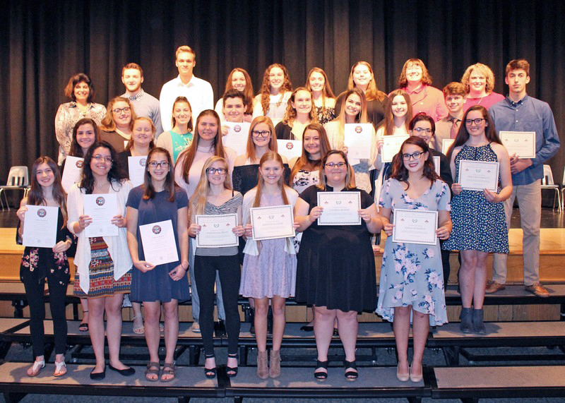 Twenty-nine IB Spanish and IB French students were inducted into the Hispanic and French Honor Societies at Hilton High School.