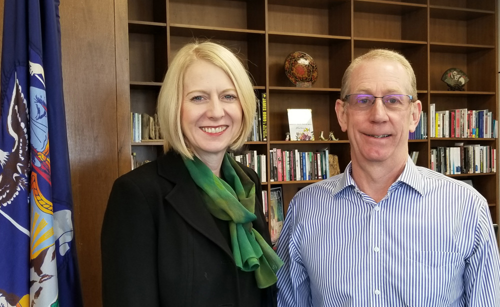 Standing in the office of the president at The College at Brockport are: President Heidi Macpherson, Ph.D. and Professor Allan Macpherson, Ph.D. Photo by Dianne Hickerson
