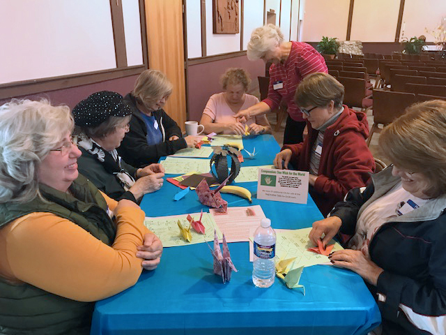 Participants learned to fold origami cranes and doves.