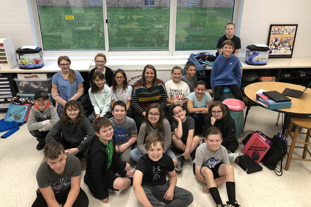 Lynnette Gall with sixth grade students.