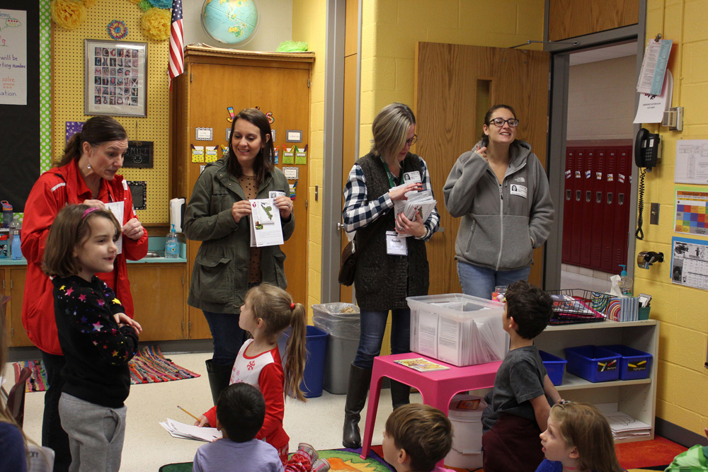 Representatives from the American Heart Association and Bonduelle USA present Byron-Bergen students with vegetable seeds. Photo by Gretchen Spittler