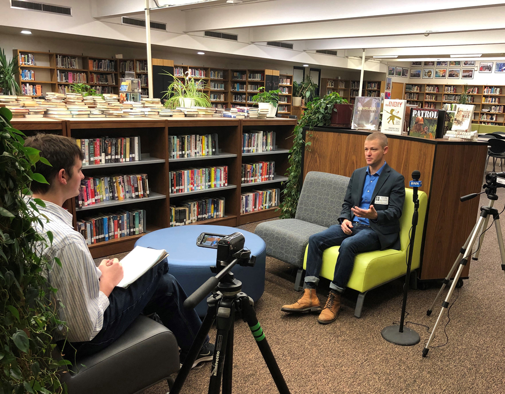 Student journalists had the opportunity to interview Ryan Smithson (right).