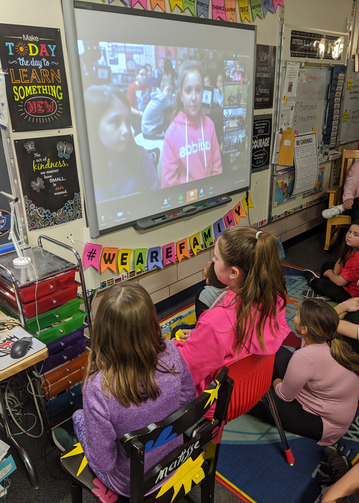 Evalyn Adams and Kara Brone, fifth graders at Village Elementary School, ask a paleontologist and ornithologist about genetic similarities in birds and dinosaurs.