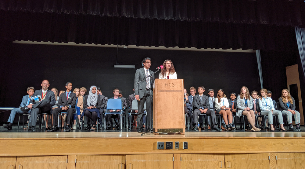 Secretaries General Hridesh Signh and Isabella Wattie address delegates at the 40th Annual Model United Nations Conference at Hilton High School on November 9.
