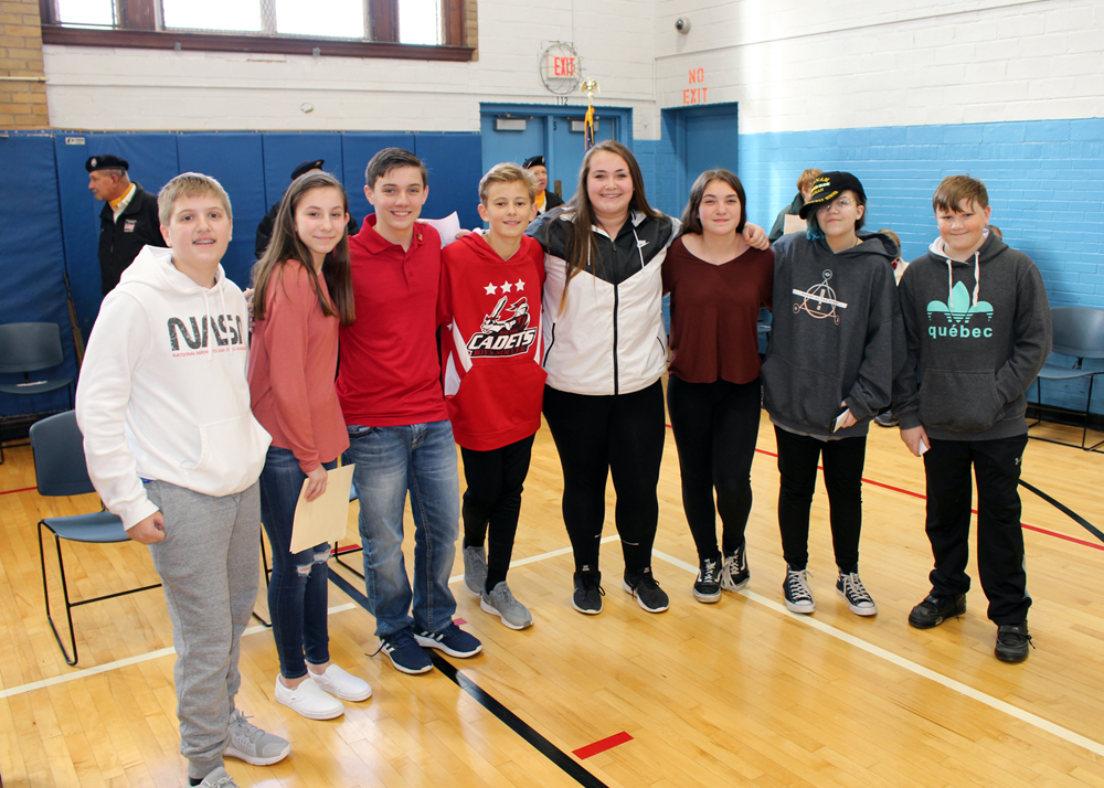 Merton Williams Middle School students spoke at the annual Hilton Veterans Day Ceremony at the Hilton Community Center. Shown are: (l-r) Tyler Reed, Natalie Hoyt, Austin DeLorme, John Ulreich, Bree Maibohm, Skylar French, Giana Mastin and Joshua Nowacki.