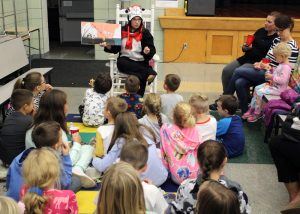 A Dr. Seuss book being read by the Cat in the Hat (librarian Colleen Wilson).