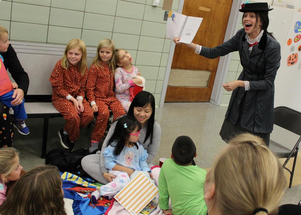 Guest reader Mary Poppins (kindergarten teacher Kerry Burnett) kept her audience spellbound.