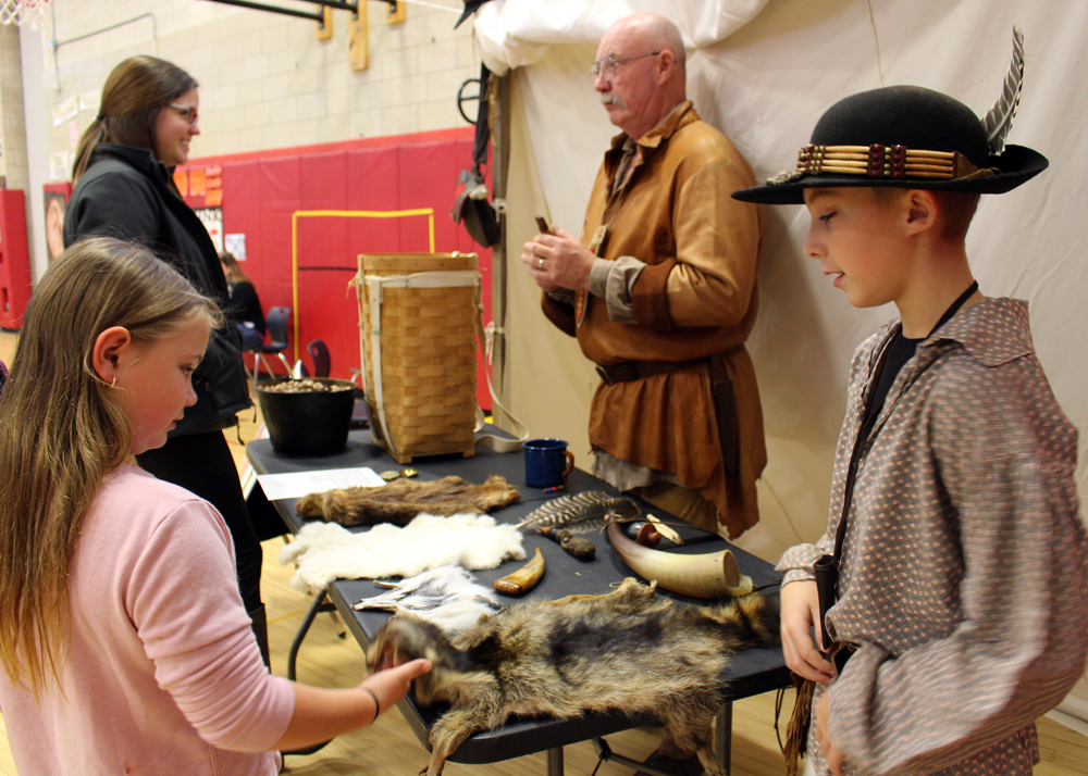 Tom Chugg and his grandson, Colton Spriggs, illustrate what life was like during the Lewis and Clark Expedition.