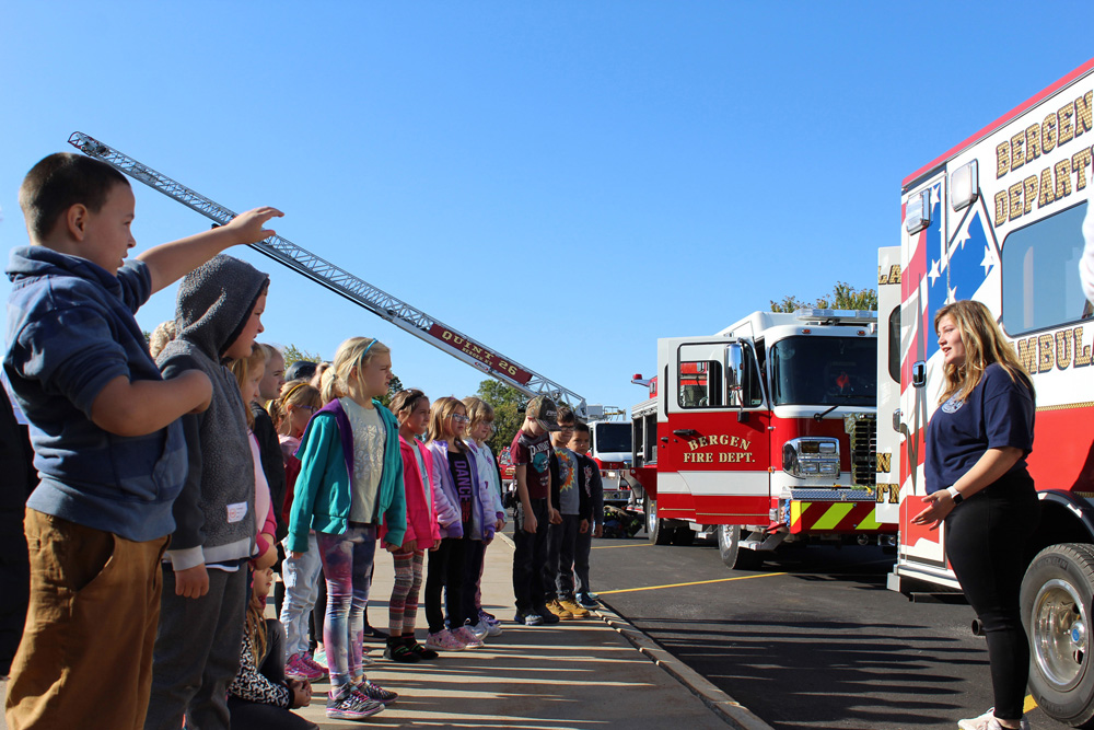 Kelly Ireland demonstrates ambulance services to Elementary School students during Fire Safety Day. Photo by Gretchen Spittler