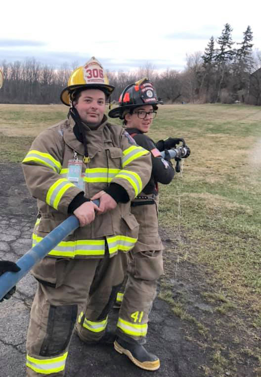 Michael Olander (r) training on fire hydrant usage, pump operation, and hose advancements with the Bergen Fire Department. Photo used with permission from the Bergen Fire Department.