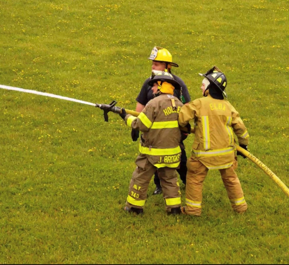 Sydney Brown (r) taking part in a training session with Elba Volunteer Fire Department. Photo used with permission from Sydney Brown.