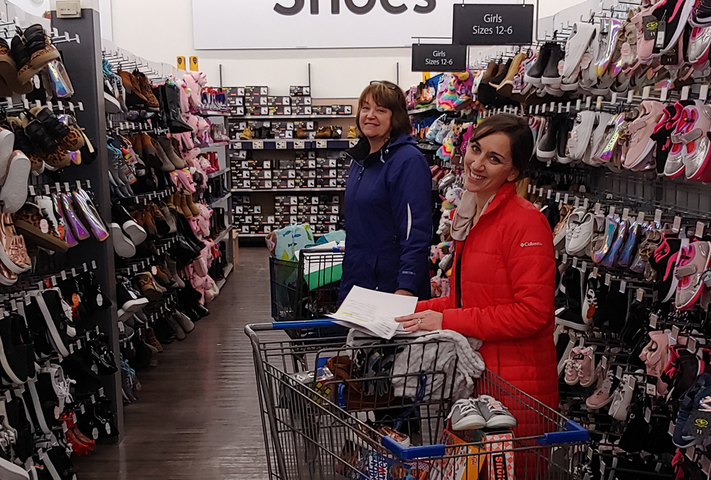 Faculty and staff use the funds raised to shop for local families. Photo by Heather Hill