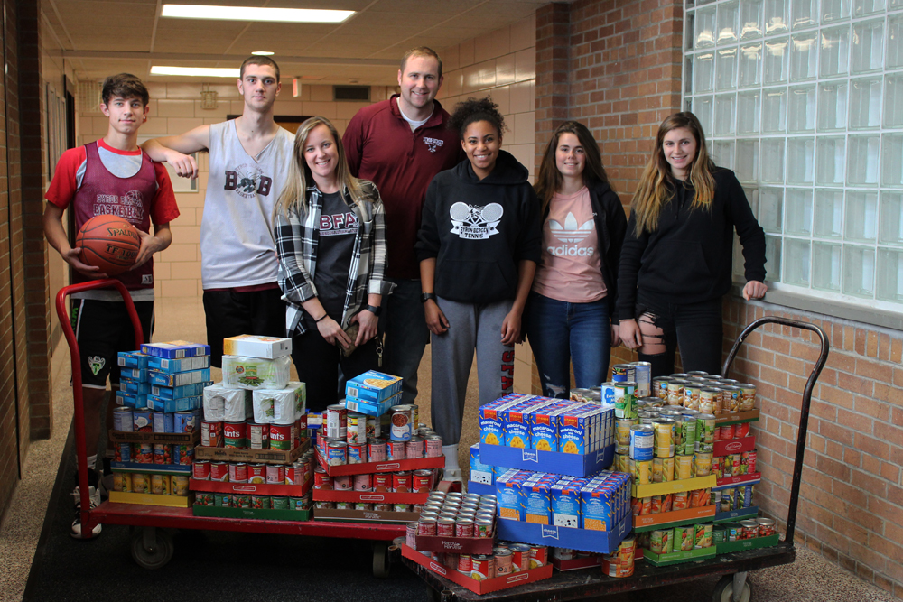 The B-B Varsity Club delivers food products to the District Office. Photo by Patricia Gunio