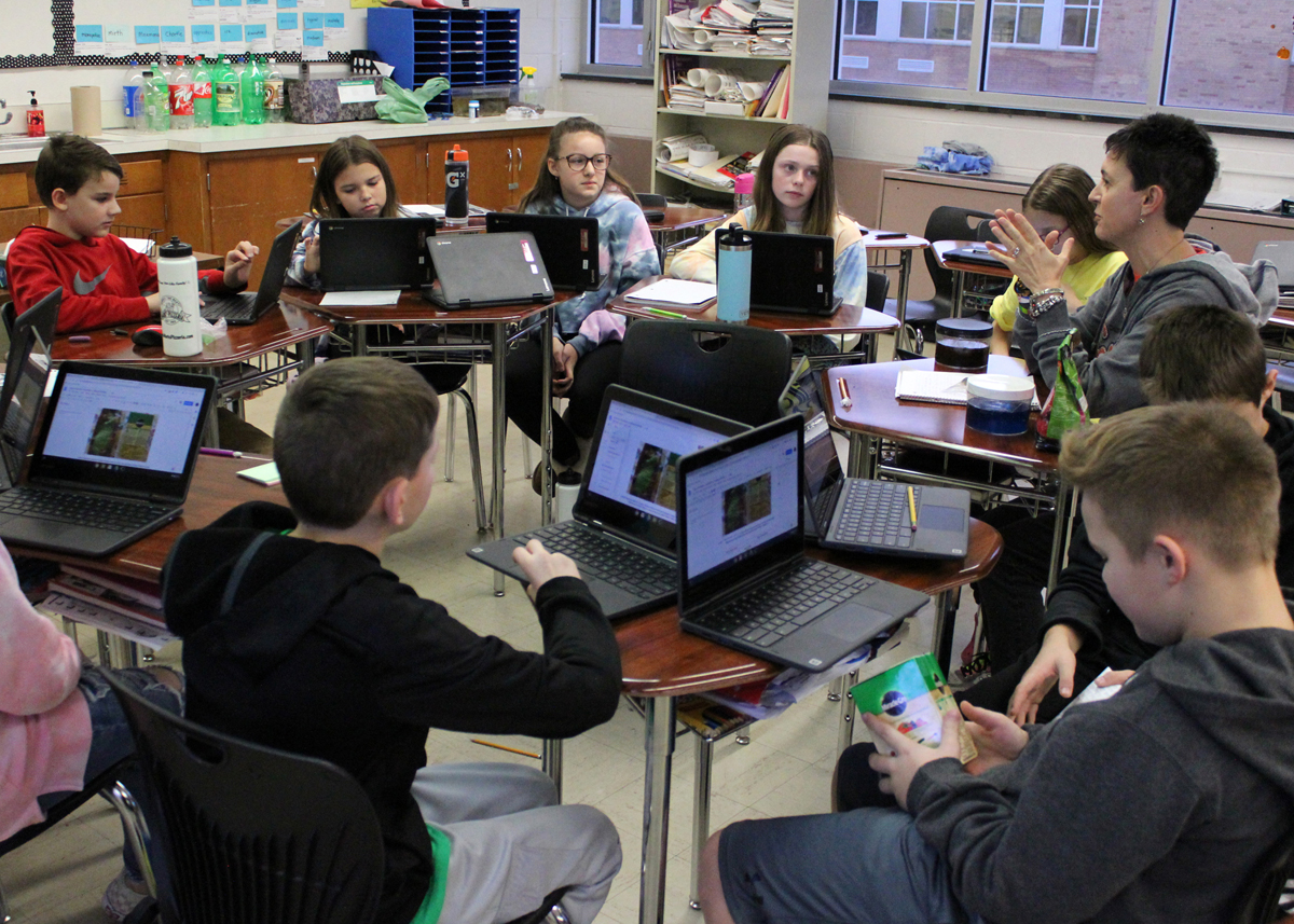 Middle school teacher Josie Cancilla-Spadafora and her class discuss the costs and benefits of organic vs. chemical fertilizers.